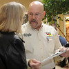 Mike Honigsberg, the Northwest Oklahoma Emergency Management Certified Director, answers a question for Donna Wall during the second annual Weather and Disaster Preparedness Day at Oakwood Mall Saturday, March 23, 2013. (Staff Photo by BONNIE VCULEK)