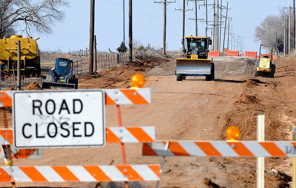 A road grater drives along 30th street north of Breckenridge Rd. Tuesday as crews repair a portion of the road. (Staff Photo by BILLY HEFTON)