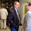 New owner of Enid Iron & metal, John Boone, visits with Oklahoma Lt. Governor Todd Lamb prior to a ribbon cutting ceremony Monday. (Staff Photo by BILLY HEFTON)