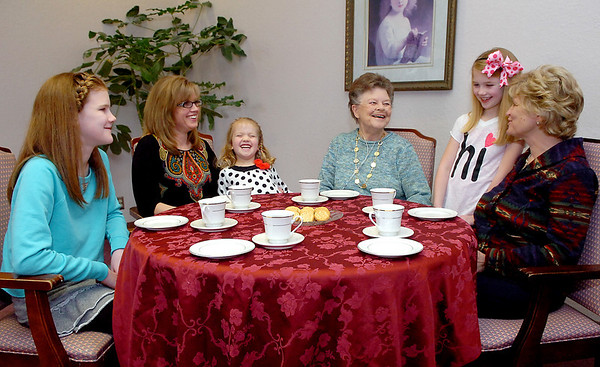 Greenbrier Assisted Living Center resident, Doris Wing (center), shares a laugh with members of her family, (left to right) Madalyn Keller, Amy Keller, Isabel Keller, Abigial Keller and Christine McCreary, during  recent visit. (Staff Photo by BILLY HEFTON)
