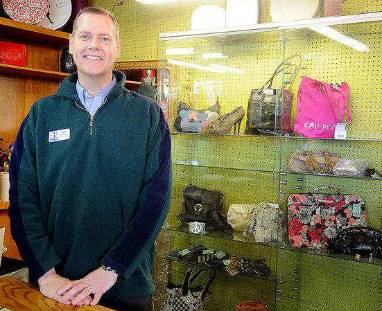 Matt Lohman pauses at Hope Outreach's specialty counter. In addition to the thrift store, Hope Outreach provides services through their community care, homeless , and parenting ministries and operates the Faith Farm Enabling Garden. (Staff Photo by BONNIE VCULEK)