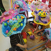 Pre-Kindergarten students wear their Easter hats at Taft Elementary School as they hide eggs inside their sand box learning center Thursday, March 28, 2013. (Staff Photo by BONNIE VCULEK)