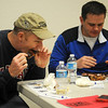 Participants in the Kansas City Barbeque Society BBQ judging class evaluate smoked ribs prepared by the Enid Noon Ambucs at Northern Oklahoma College-Enid Gantz Center Saturday, March 9, 2013. (Staff Photo by BONNIE VCULEK)