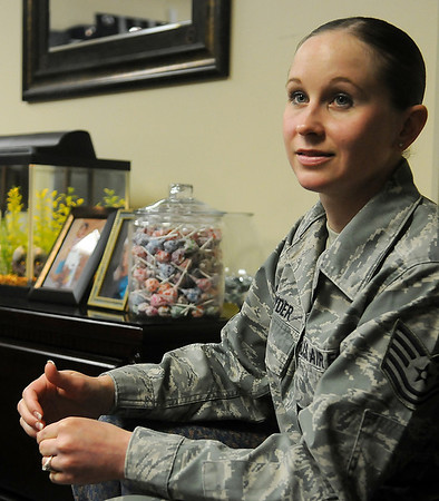Tech Sgt. Amy Snyder, the Family Readiness NCO for Vance Air Force Base, discusses the services that her office provides Tuesday, March 12, 2013. (Staff Photo by BONNIE VCULEK)