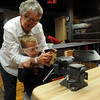 Rhett Tripp (seated) and his grandmother, Bari Meyer, saw a block of wood together in the new Tinkering exhibit at Leonardo's Discovery Warehouse Friday, March 15, 2013. The Oklahoma Museum Network permanent exhibit was funded by Donald W. Reynolds Foundation. (Staff Photo by BONNIE VCULEK)