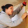 Kelsey Calemba, from Milwaukee, Wis. reads a wood trim measurement to fellow Marquette University students as they help build a Habitat for Humanity home for an Enid family Wednesday, March 13, 2013. Eighteen students chose to do a week of community service in Enid during their spring break vacation. (Staff Photo by BONNIE VCULEK)