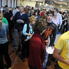 Guests form a line at the Enid High School Food Court during the Festival of Flavor Tuesday, March 12, 2013. More than 30 of Enid's finest eateries offer samples of their cuisine. Rotary Club members host the event to help Enid Public Schools purchase technical equipment and for worldwide polio eradication. (Staff Photo by BONNIE VCULEK)