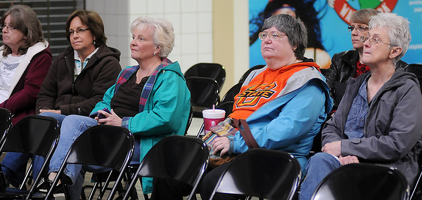 Individuals listen as Rick Smith, from the National Weather Service in Norman, presents a program on Weather Safety during the second annual Weather and Disaster Preparedness Day at Oakwood Mall Saturday, March 23, 2013. (Staff Photo by BONNIE VCULEK)