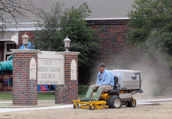 A gentleman mows the lawn at First Presbyterian Church as he prepares the landscape for Easter Sunday services Wednesday, March 27, 2013. (Staff Photo by BONNIE VCULEK)