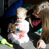 "Sara Curttright and her six-month-old daughter, Berlyn, enjoy ""open play"" time at the CDSA Non-Profit Center Early Childhood Development Program Wednesday, March 20, 2013. (Staff Photo by BONNIE VCULEK)"