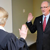 Dr. David Vanhooser takes the oath of office of Municipal Judge Linda Pickens for the commission for Ward 6 Tuesday during a special meeting. (Staff Photo by BILLY HEFTON)