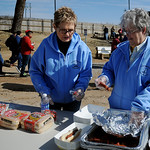 Hope Outreach Parenting Ministry staff prepare 1,000 hot dogs for middle school age boys during the Boys Tailgate party at Northern Oklahoma College-Enid Wednesday, March 13, 2013. Over 400  ...