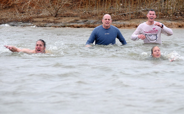 MSgt. John Ward, retired, Col. Darren James, Vance Air Force Base Commander of the 71st Flying Training Wing, Adam Smith and Sherry Ginger begin the final lap across Crosslin Park Lake during the Warren Edds Memorial Civitan Chiller Challenge Saturday, March 9, 2013. (Staff Photo by BONNIE VCULEK)