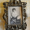 Ursula Tuohy sits on a naughty chair in this childhood portrait of her in Ireland. The photograph along with several other mementos from her Irish home fill the Tuohy residence at 2102 W. Broadway in Enid. (Staff Photo by BONNIE VCULEK)