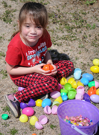 Gabriela Ayala, from Enid, opens her colorful Easter eggs after the Easter egg hunt at Sandbox Learning Center Saturday, March 30, 2013. (Staff Photo by BONNIE VCULEK)