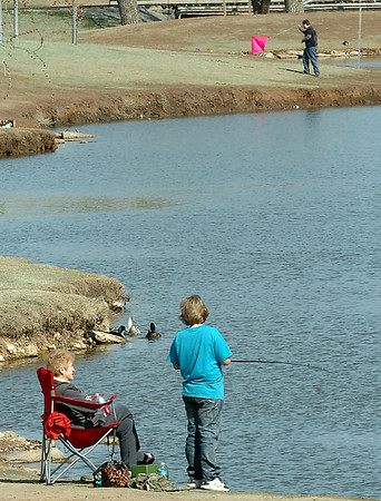 Fishing and kite flying were the order of the day at Meadowlake Park Wednesday. (Staff Photo by BILLY HEFTON)