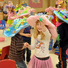 Melia Kelley found the first Easter egg during the Pre-Kindergarten class hunt at Taft Elementary School Thursday, March 28, 2013. The children in Mrs. Nancy Killam's classroom designed the brightly colored hats for their Easter parade. (Staff Photo by BONNIE VCULEK)