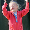 Waukomis' Kamryn Sissney celebrates her first place finish in the 50-yard dash during a Special Olympics' Track and Field award ceremony Thursday, March 28, 2013 at Vance Air Force Base. Sixteen teams with nearly 200 athletes participated in the day's events. (Staff photo by BONNIE VCULEK)