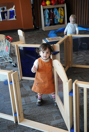 "Nicole Aguilera opens a door as she plays during the weekly Early Childhood Development ""open play"" time at the CDSA Non-Profit Center. Parents are encouraged to bring their young children and spend time together at the facility each Wednesday morning. (Staff Photo by BONNIE VCULEK)"