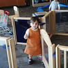 """Nicole Aguilera opens a door as she plays during the weekly Early Childhood Development """"open play"""" time at the CDSA Non-Profit Center. Parents are encouraged to bring their young children and spend time together at the facility each Wednesday morning. (Staff Photo by BONNIE VCULEK)"""