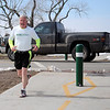 A gentleman trains for the April 28, 2013 RUNRemember on the Enid Trails as a vehicle drives south on Cleveland Saturday, March 2, 2013. (Staff Photo by BONNIE VCULEK)