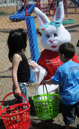 The Easter Bunny visits with children prior to the egg hunt at Sandbox Learning Center, 411 E. Illinois, Saturday, March 30, 2013. Employees at the center and Northwestern Oklahoma State University Psychology Club members filled thousands of eggs with candy before children arrived for the fun. (Staff Photo by BONNIE VCULEK)