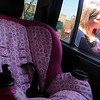 Celeste Spargo gives her daughter, Abigail Martin, a kiss before buckling her into her child safety seat Wednesday, March 20, 2013. (Staff Photo by BONNIE VCULEK)