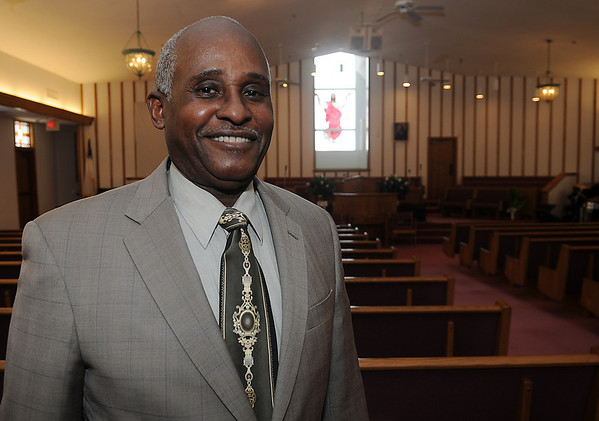 The Rev. Alfred Baldwin II stands inside the sanctuary at First Missionary Baptist Church Wednesday, March 6, 2013. Rev. Baldwin has been a minister for the congregation for 35 years. (Staff Photo by BONNIE VCULEK)