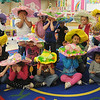 Pre-kindergarten students in Mrs. Nancy Killam's classroom at Taft Elementary School cover their eyes or peek as their teacher hides Easter eggs for them to find Thursday, March 28, 2013. The students created their brightly colored hats for Easter activities. (Staff Photo by BONNIE VCULEK)