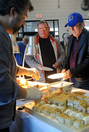 David North, executive chef for Oakwood Country Club, carves turkey for incredible sandwiches during the Festival of Flavor at the Enid High School Food Court Tuesday, March 12, 2013. The Rotary hosts the event to help fund Enid Public School's purchase of technical equipment and for worldwide Polio eradication. (Staff Photo by BONNIE VCULEK)
