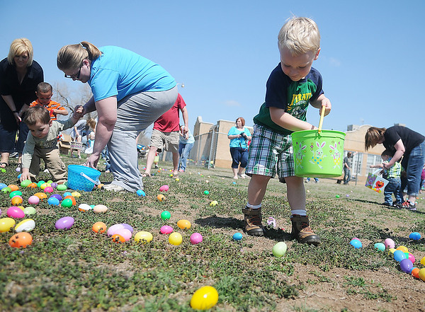 Kurtis Lankard, Jr. (right), from Billings, collects Easter eggs with other children at Sandbox Learning Center Saturday, March 30, 2013.
