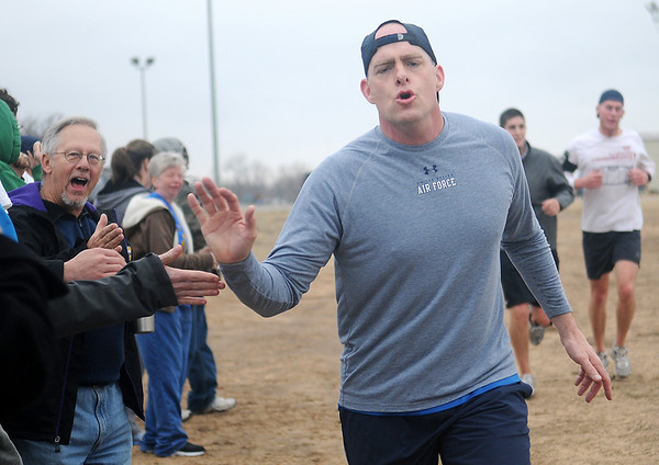 Col. Darren James, Commander of the 71st Flying Training Wing at Vance Air Force Base, receives congratulations from the crowd as he finishes the Warren Edds Memorial Civitan Chiller Challenge 5K Run Saturday, March 9, 2013. Proceeds from the event benefit special olympics. (Staff Photo by BONNIE VCULEK)
