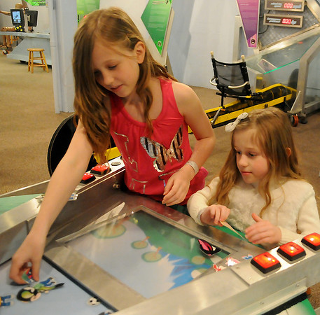Abigail and Emma Culbertson (from left) enjoy a fun-filled spring day at Leonardo's Discovery Warehouse Thursday, March 21, 2013. (Staff Photo by BONNIE VCULEK)
