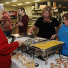 Cafe Garcia serves their special Mexican cuisine to guests at the Rotary Club's Festival of Flavor in the Enid High School Food Court Tuesday, March 12, 2013. Proceeds from the event support the purchase of Enid Public Schools' technical equipment and for worldwide polio eradication. (Staff Photo by BONNIE VCULEK)
