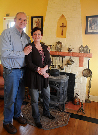 Kevin and Ursula Tuohy pause in their front living room at 2102 W. Broadway near mementos from Ursula's childhood home in Ireland Tuesday, March 12, 2013. (Staff Photo by BONNIE VCULEK)