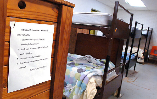A list of rules hangs in the men's dorm at the Enid Salvation Army. (Staff Photo by BILLY HEFTON)