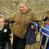 Shelby Frost and her grandmother, Arleen Mack, pause near Frost's ewe pens during the Northwest District Junior Livestock Show at the Chisholm Trail Expo Center Wednesday, March 6, 2013. Frost, a fifth-grade student from Mulhall, uses her wheelchair with a special handling bracket as she shows her animals. Frost won a Northwest District Junior Livestock Show showmanship jacket for her efforts in the ring with her Shropshire named Sophie. (Staff Photo by BONNIE VCULEK)