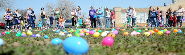 One and two-year olds line up with their parents for the Easter egg hunt at Sandbox Learning Center Saturday, March 30, 2013. The center's employees and Northwestern Oklahoma State University Psychology Club filled thousands of eggs with candy before children arrived for the fun. (Staff Photo by BONNIE VCULEK)