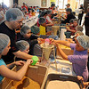 Pre-K through fifth grade students, teachers and staff package more than 10,000 meals for Kids Against Hunger in the Leven Center at St. Joseph Catholic School Friday, March 15, 2013. Deacon Tony Crispo (left) and Carol Roller (top right) organized the event as the students' Lenten project. (Staff Photo by BONNIE VCULEK)