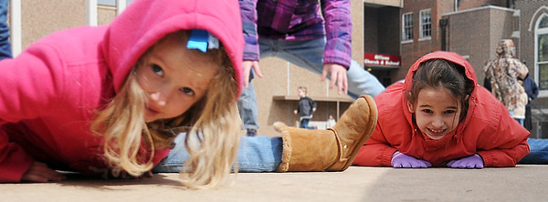 Lily Eckert (left) and Courtney Coffman do the splits as they relax during the noon recess at St. Paul's Lutheran Church and School Friday, March 1, 2013. (Staff Photo by BONNIE VCULEK)