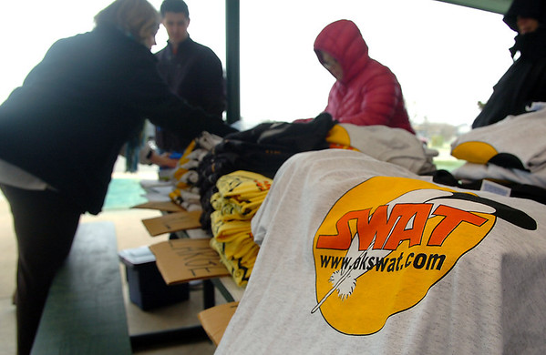 Organizers brave the cold Sunday at Meadowlake Park during Kick Butts Day, an annual event that informs youths about the dangers of tobacco, sponsored by the Garfield County Tobacco Free Coalition, United Way of Enid and Northwest Oklahoma and S.W.A.T (Students Working Against Tobacco). (Staff Photo by BILLY HEFTON)