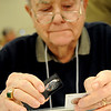Marvin Krepps, from Ponca City, examines a coin during the Spring Coin, Token and Collectibles Show at the Chisholm Trail Expo Center Pavilion Friday, March 1, 2013. The show, sponsored by the Enid Coin Club, continues Saturday, from 9 a.m.-5 p.m. and Sunday, 9 a.m.-3 p.m. (Staff Photo by BONNIE VCULEK)