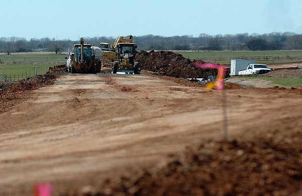 Construction on the rerouting of Southgate Road to make way for the expansion of a runway at Woodring Airport. (Staff Photo by BILLY HEFTON)