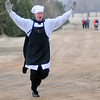 Eric Brunken, an AdvancePierre Foods training and development manager, completes his one lap fun run during the 7th annual Warren Edds Memorial Civitan Chiller Challenge at Crosslin Park Lake Saturday, March 1, 2014. Brunken, who won the event costume contest, took the chiller challenge plunge with other swimmers to help raise money for special olympics activities in Enid. (Staff Photo by BONNIE VCULEK)