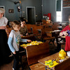 Turkey Creek School marm Dee Taylor, Haley Trybus, Shawnra Green and Alexis Owens (from left) create spring decorations for the school at the Cherokee Strip Regional Heritage Center's Humphrey Heritage Village Saturday, March 8, 2014. (Staff Photo by BONNIE VCULEK)