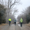 Large snowflakes fall as runner near the end of their second, 6-mile loop during the All Day Run for Autism Saturday, March 8, 2014. (Staff Photo by BONNIE VCULEK)