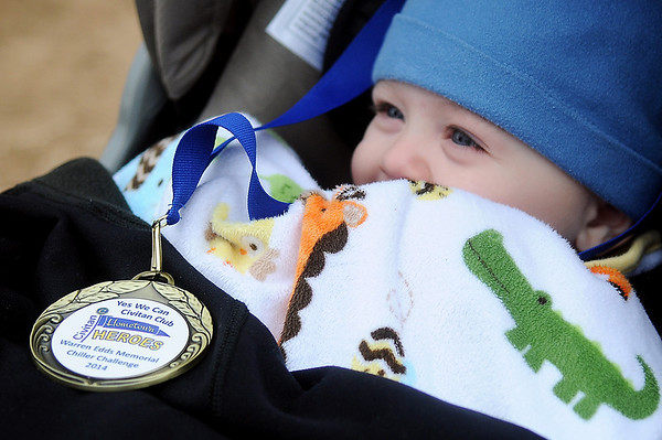Little Levi Barron peers from beneath his blanket after placing in the Yes We Can Civitan Club 5K Run during the 7th annual Warren Edds Memorial Chiller Challenge. Proceeds from the event support special olympics activities in Enid. (Staff Photo by BONNIE VCULEK)