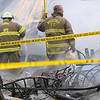Police crime scene tape surrounds the location of a fatal house fire after firefighters from Lahoma, Drummond, Hillsdale-Carrier, Ringwood, Major County Rural Water, Meno and Waukomis responded to the scene Wednesday, March 5, 2014. The body of an unidentified victim was discovered after the blaze was brought under control. (Staff Photo by BONNIE VCULEK)