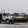 Trrucks from the Oklahoma Department of Transportation wait for the go ahead Sunday before the snow began ot fall. (Staff Photo by BILLY HEFTON)