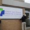Jacob McBride, Jessie Kline and Joe Kline (from left), with Kline Signs, install the new business signage at Great Salt Plains Health Center, 1101 E. Broadway, Friday, March 7, 2014. (Staff Photo by BONNIE VCULEK)